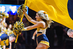 Feb 6, 2016; Morgantown, WV, USA; A West Virginia Mountaineers cheerleader performs before their game against the Baylor Bears at the WVU Coliseum. Mandatory Credit: Ben Queen-USA TODAY Sports