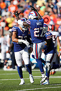 Buffalo Bills strong safety Micah Hyde (23) celebrates with leaping Buffalo Bills rookie cornerback Tre'Davious White (27) and Buffalo Bills cornerback E.J. Gaines (28) after the Bills break up a fourth down fourth quarter pass attempt by the Denver Broncos with less than two minutes left in the game during the 2017 NFL week 3 regular season football game against the against the Denver Broncos, Sunday, Sept. 24, 2017 in Orchard Park, N.Y. The Bills won the game 26-16. (©Paul Anthony Spinelli)