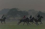 It's polo season in India, amid heavy fog and the well-bred man and horse alike are again face off on grassy field, endlessly mingling sport and spectacle at the Jaipur Polo Ground in New Delhi, India Friday Nov. 1, 2002.  When the heat of summer fades, and the winter haze settles over the Indian plains, the rich return to the playing fields of New Delhi, and the sport of the maharajas returns to this ancient city.
