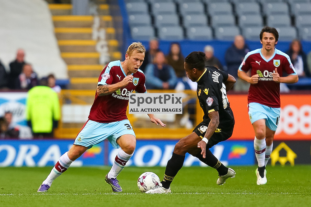 Scott Arfield of Burnley in action with Neil Danns of Bolton Wanderers during Burnley v Bolton, Sky Bet Championship, 17 October 2015,  (c) Jackie Meredith/SportPix.org.uk