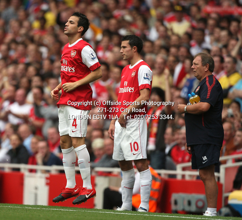 21/08/2010 Premier League Football. Arsenal v Blackpool.<br /> Arsenal substitutes Cesc Fabregas and Robin van Persie wait to join the action.<br /> Photo: Mark Leech.