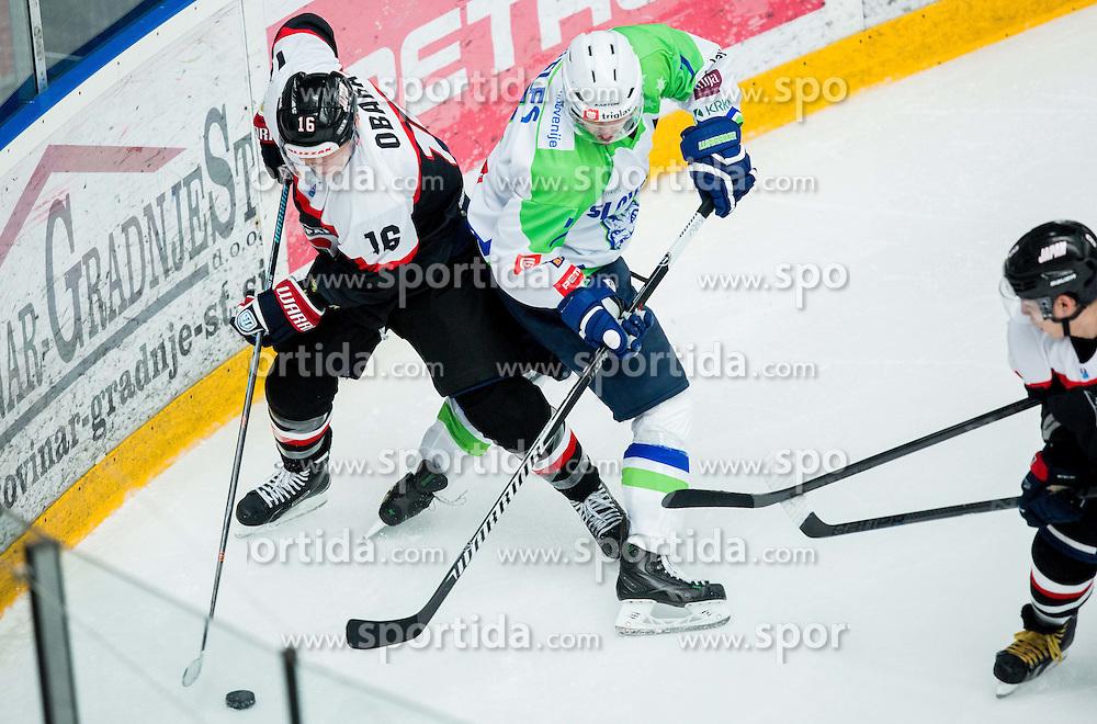 Daisuke Obara of Japan vs Klemen Pretnar of Slovenia during ice-hockey friendly match between National teams of Slovenia and Japan, on April 10, 2015 in Arena Podmezakla, Jesenice, Slovenia. Photo by Vid Ponikvar / Sportida