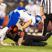 20 October 2018: San Diego State Aztecs safety Parker Baldwin (33) makes an open field tackle on San Jose State Spartans wide receiver Thai Cottrell (22) in the first quarter. The Aztecs beat the Spartans 16-13 Saturday night at SDCCU Stadium.