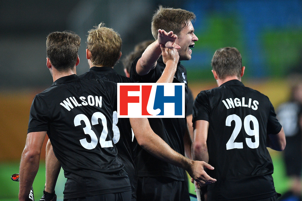 New Zealand's Nick Wilson (L) celebrates scoring a goal with his teammates during the mens's field hockey Belgium vs New Zealand match of the Rio 2016 Olympics Games at the Olympic Hockey Centre in Rio de Janeiro on August, 12 2016. / AFP / Carl DE SOUZA        (Photo credit should read CARL DE SOUZA/AFP/Getty Images)