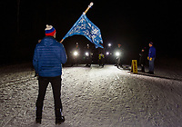 Kale Poland and Sander Valpey set the racers at the starting line for the Fatbike Fury night race at Gunstock Saturday evening.  (Karen Bobotas/for the Laconia Daily Sun)