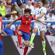 Morgan Brian, U.S. Women's National Team and So-Yun Ji, (left), Korean Republic, challenge for the ball during the U.S. Women's National Team Vs Korean Republic, International Soccer Friendly in preparation for the FIFA Women's World Cup Canada 2015. Red Bull Arena, Harrison, New Jersey. USA. 30th May 2015. Photo Tim Clayton