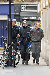 J11 protest.<br /> Police detain a protestor following the occupation of a house on Beak St, Soho during the J11 protest in central London by the StopG8 anti-capitalist movement,<br /> London, United Kingdom<br /> Tuesday, 11th June 2013<br /> Picture by Mark  Chappell / i-Images