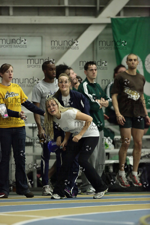 (Windsor, Ontario---12 March 2010) \fans\ competes in the 4x800m final at the 2010 Canadian Interuniversity Sport Track and Field Championships at the St. Denis Center. Photograph copyright Geoff Robins/Mundo Sport Images. www.mundosportimages.com