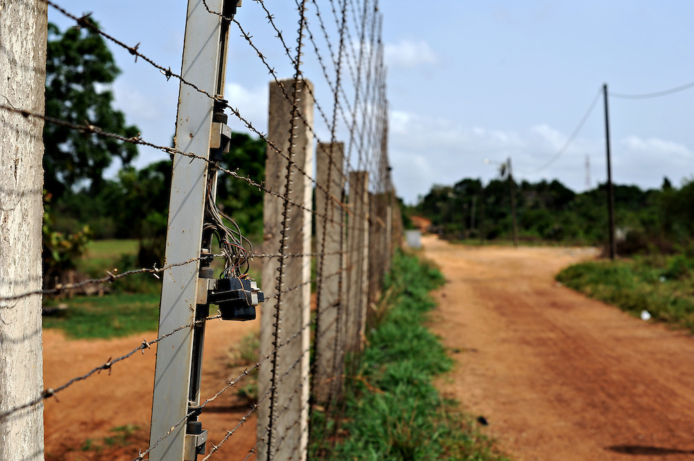 12-03-04  --  LOMÉ, TOGO  --  The border fence between Ghana and Togo. In some places the fence is missing, allowing free passage. Photo by Daniel Hayduk