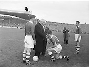 Cork captain kissing the hand of the Bishop before the start of the All Ireland Senior Gaelic Football Championship Final Louth v Cork at Croke Park on the 22nd September 1957. Louth 1-09 Cork 1-07.