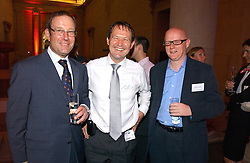 Left to right, RICHARD DESMOND, SIMON WALKER and DAVID YELLAND at the Reuters Summer Party held in The Sackler Octagon, Tate Britain, Millbank, London SW1 on 27th July 2006.<br />