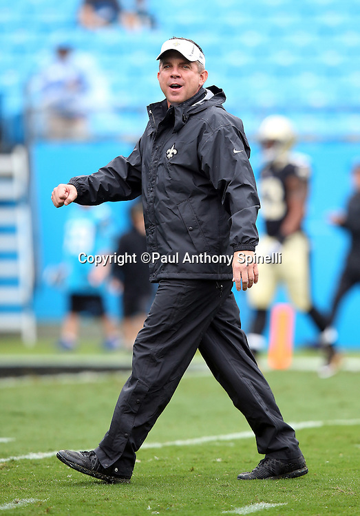 New Orleans Saints head coach Sean Payton calls out while the team warms up before the 2015 NFL week 3 regular season football game against the Carolina Panthers on Sunday, Sept. 27, 2015 in Charlotte, N.C. The Panthers won the game 27-22. (©Paul Anthony Spinelli)