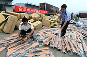 JINHUA, CHINA - SEPTEMBER 25: (CHINA OUT) <br /> <br /> Custom officers and policemen examine simulated guns captured from smuggling cases at Jindong District on September 25, 2014 in Jinhua, Zhejiang province of China. The Jinhua customs have solved 20 smuggling cases and captured more than 70,000 simulated guns in over 20 kinds since 2011.<br /> ©Exclusivepix