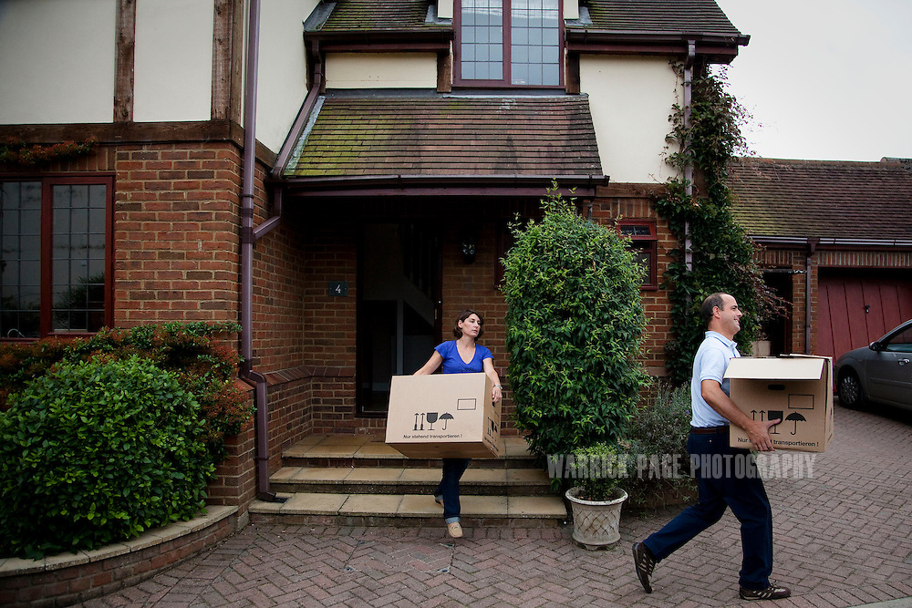 Julio and Eva Vildosola carry boxes to the garage at their new home, on September 1, 2012, in Buckden, England. The Spanish family immigrated to England due to the ongoing economic crisis that has impacted heavily on Spain. (Photo by Warrick Page)