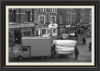 View of brick lane market from junction with bethnal green road finishing up for the daySeries of Black and White pictures Depicting Brick Lane Market London,  2 feb 1984<br />