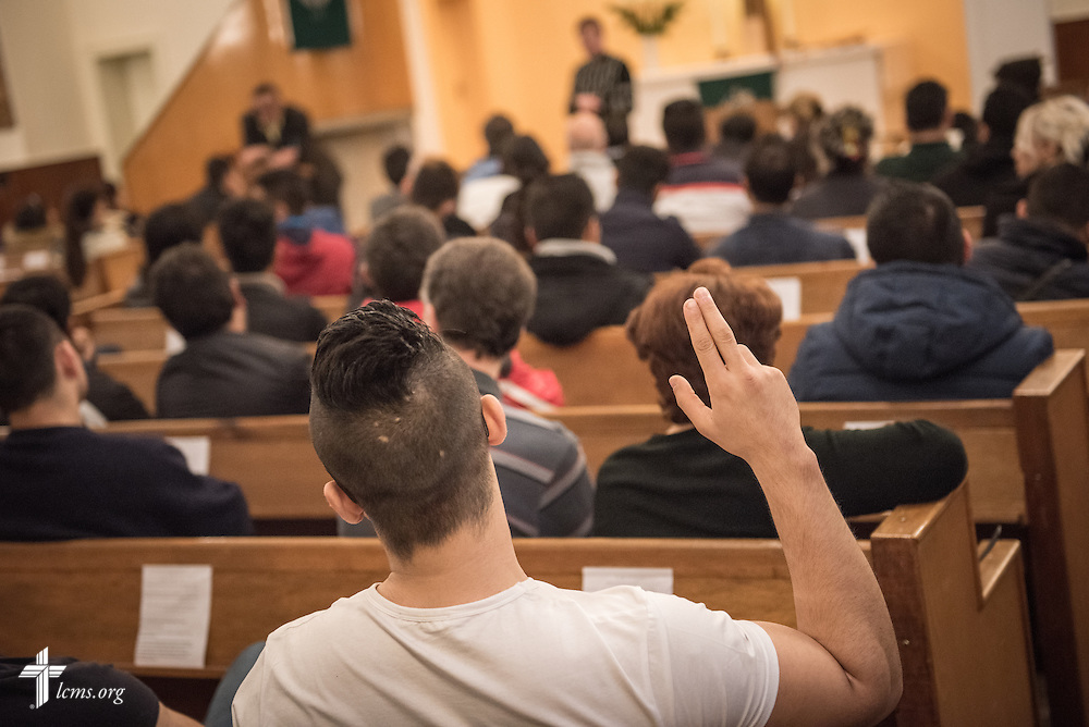 A refugee raises his hand to ask a question to the Rev. Dr. Gottfried Martens during Bible study on Saturday, Nov. 14, 2015, at the Dreieinigkeits-Gemeinde, a SELK Lutheran church in Berlin-Steglitz, Germany.  LCMS Communications/Erik M. Lunsford