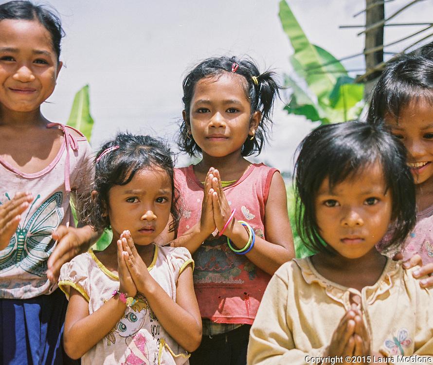 Laos - beautiful children saying thank you Southeast Asia