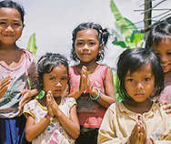 Laos - beautiful children saying thank you Southeast Asia