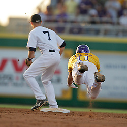 05 June 2009:  Tyler Hanover (11) of LSU dives safely into second base before Brock Holt of Rice can make a tag during game one of the NCAA baseball College World Series, Super Regional game between the Rice Owls and the LSU Tigers at Alex Box Stadium in Baton Rouge, Louisiana.