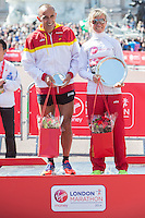 Maria Parades Rodriguez of Spain, winner of the Women's T11-13 IPC race on the podium at the Virgin Money London Marathon 2014 at the finish line on Sunday 13 April 2014<br /> Photo: Dillon Bryden/Virgin Money London Marathon<br /> media@london-marathon.co.uk