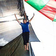 Mohamad jumping on the trampoline, under the tent of Palestinian Circus School in Birzeit