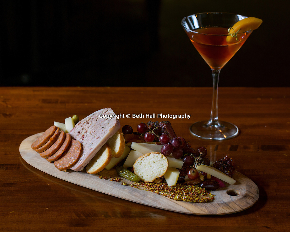A Charcuterie and Cheese Board with a Peach Whiskey Manhatten at Tusk and Trotter on Friday, February 19, 2016, in Bentonville, Arkansas. Beth Hall for the New York Times