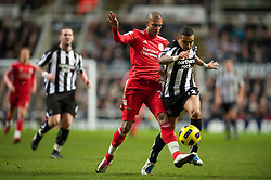 NEWCASTLE, ENGLAND - Saturday, December 11, 2010: Liverpool's David Ngog and Newcastle United's Danny Simpson during the Premiership match at St James' Park. (Photo by: David Rawcliffe/Propaganda)