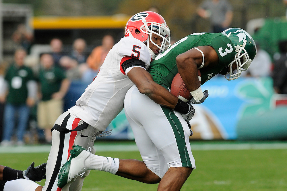 January 1, 2009: C.J. Byrd of the Georgia Bulldogs tackles B.J. Cunningham of the Michigan State Spartans during the NCAA football game between the Michigan State Spartans and the Georgia Bulldogs in the Capital One Bowl. The Spartans were leading the Bulldogs 6-3 at halftime.