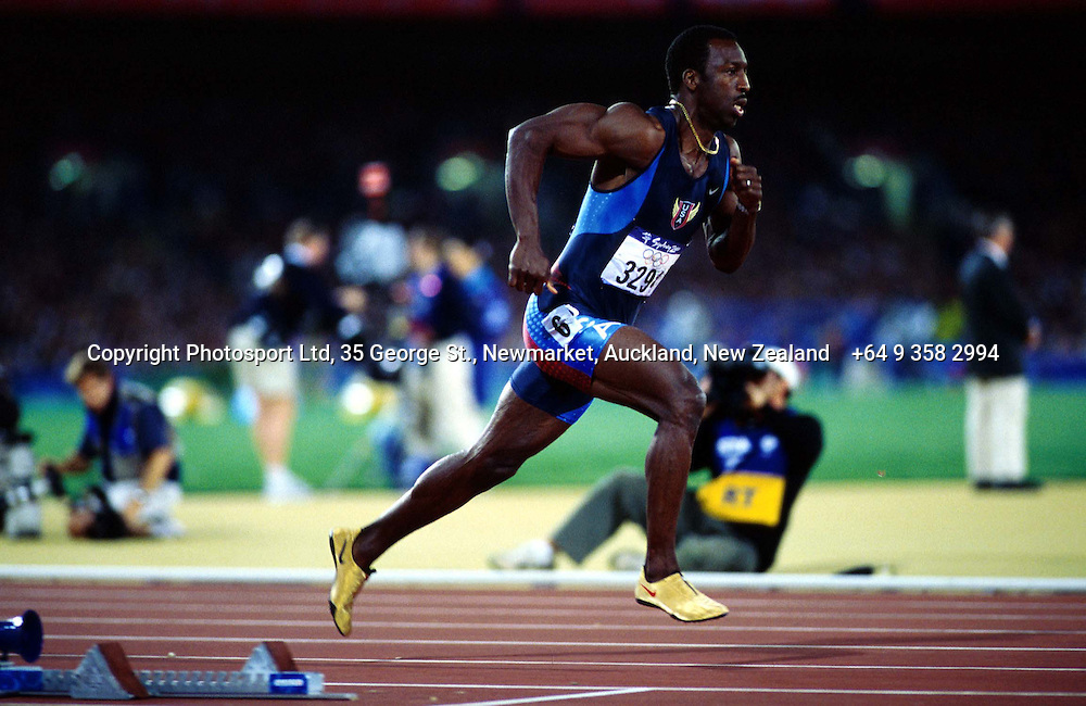 Michael Johnson of the United States races in the mens 400m at the Olympics, Sydney, Australia, 25 September 2000.  Johnson won the gold medal.  PHOTO: PHOTOSPORT
