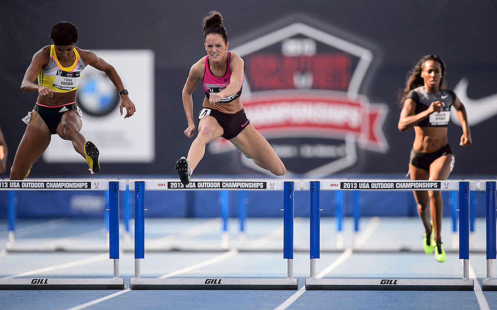 The USA track & field championships in Des Moines, Iowa-Day 2:  Georganne Moline (middle) leads T'erea Brown (left) and Christine Spence (right) in semi-final of the 400 meter hurdles.