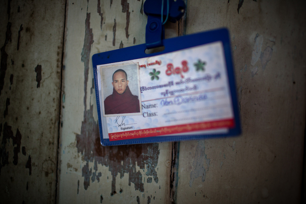 An identification card of one of the monks in a small monastery hangs on the wall.