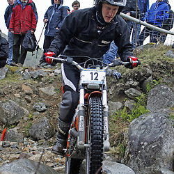Stephen Dixon England  tries hard to negotiate the heavy boulders on the lagnaha section near duror in argyll.  The six day trial pits man and machine against the heavy highland terrain with the winner having he best times on each of the stages at the end of the six days. picture kevin mcglynn | STOCKPIX