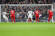 Tottenham Hotspur forward Harry Kane (10) scores a goal (2-4) after taking a penalty kick during the Champions League match between Tottenham Hotspur and Bayern Munich at Tottenham Hotspur Stadium, London, United Kingdom on 1 October 2019.
