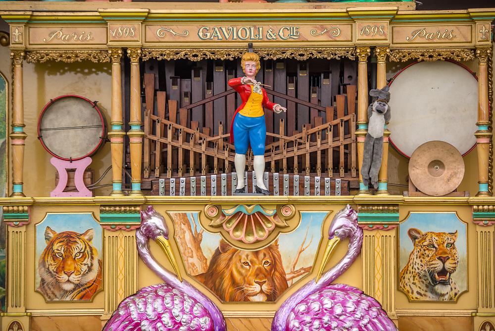 Close up of female conductor figure adorning fairground organ, Masham, North Yorkshire, UK