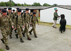 © Licensed to London News Pictures.16/07/15<br /> Harrogate, UK. <br /> <br /> A troop of soldiers march past a Shetland pony on the final day of the Great Yorkshire Show.  <br /> <br /> England's premier agricultural show has seen three days of showcasing the best in British farming and celebrating the countryside.<br /> <br /> The event which attracts over 130,000 visitors each year displays the cream of the country's livestock and offers numerous displays and events giving the chance for visitors to see many different countryside activities.<br /> <br /> Photo credit : Ian Forsyth/LNP
