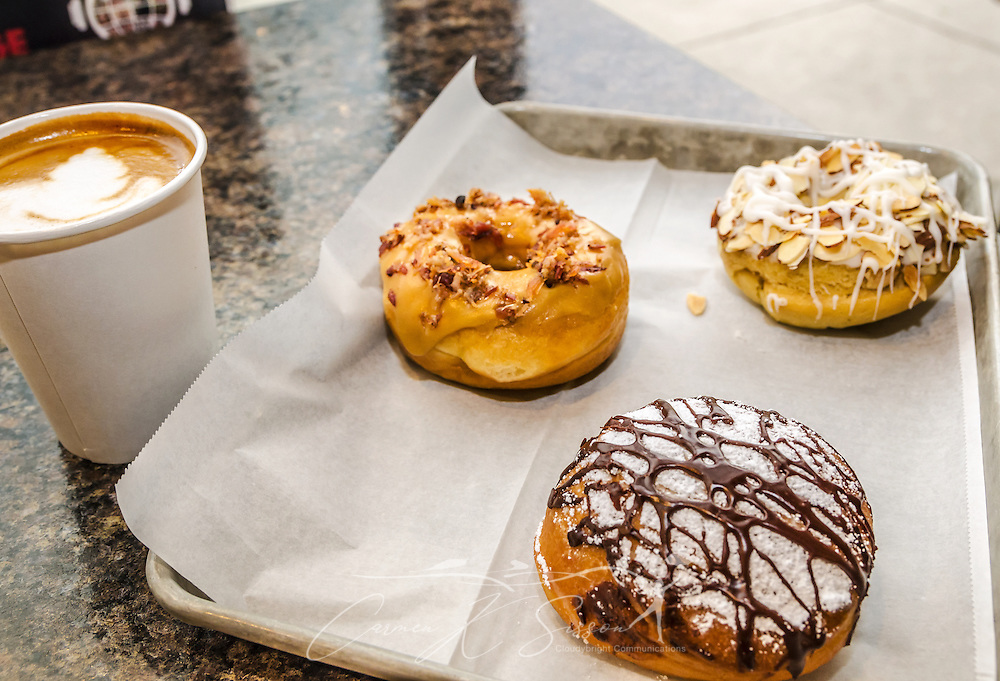 A Nutella latte is served with a toasted coconut almond doughnut, salted caramel bacon doughnut, and Nutella-filled cream puff at Revolution Doughnuts & Coffee, June 12, 2014, in Decatur, Georgia. The family-owned business opened in 2012. (Photo by Carmen K. Sisson/Cloudybright)