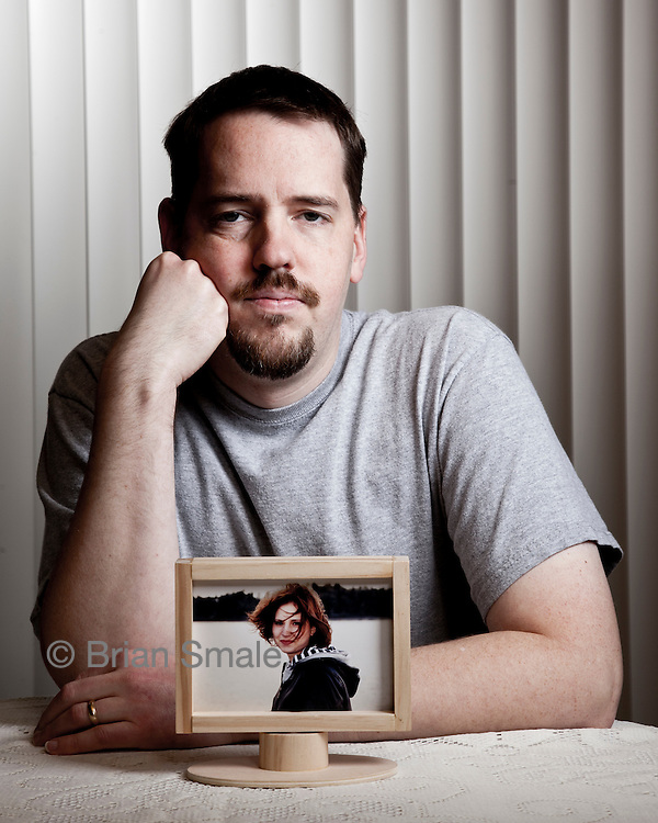 Josh Powell.  Josh's wife Susan Powell disappeared from their Utah home in Dec 2009.  Photographed with a photo of Susan Powell, at the home of Steve Powell (Josh's father) near Tacoma WA for People Magazine. On Sunday Feb 5 2012, Josh Powell caused an explosion in his home, killing himself and his two children Charles and Braden.