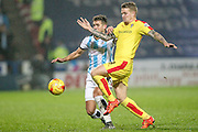 Danny Ward (Rotherham United) stretches for the ball to keep out Tommy Smith (Huddersfield Town) during the Sky Bet Championship match between Huddersfield Town and Rotherham United at the John Smiths Stadium, Huddersfield, England on 15 December 2015. Photo by Mark P Doherty.