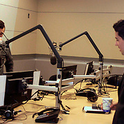 Andy Valgas checks the mic before the interview with Simon Rios at WBUR- NPR Boston.<br /> <br /> Valgas, 22, is the newest elected Haverhill city council. He is also the first Latino elected to a government position in the city history. <br /> <br /> Andy holds a mayor from BU in Political Science and worked as an interned for the Obamas White House.<br /> ---------------------------------------------------<br /> Andy Valgas, recien elegido City Council en Haverhill. El recibe una calurosa bienvenida a WBUR, NPR - National Public Radio - Boston. Fue entrevistado por Simón Rios. Valgas conversó brevemente con Ileana Cintron quien trabaja en Kennedy School of Goverment y con el reportero Bruce Gellermen.