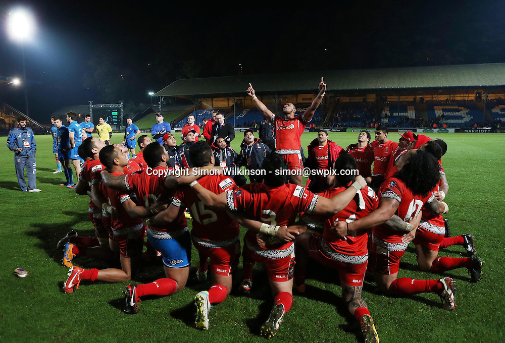 Picture by Vaughn Ridley/SWpix.com - 10/11/2013 - Rugby League - Rugby League World Cup - Tonga v Italy - the Shay Stadium, Halifax, England - Tonga perform their Haka after the final whistle.