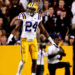 November 10, 2012; Baton Rouge, LA, USA; LSU Tigers cornerback Tharold Simon (24) signals incomplete during the first half of a game against the Mississippi State Bulldogs at Tiger Stadium.  Mandatory Credit: Derick E. Hingle-US PRESSWIRE