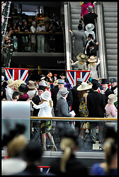Race-goers inside the Grandstand at Royal Ascot watch the HM The Queen and The Duke of Edinburgh arrive on the Final Day of Royal Ascot, Saturday June 23, 2012. Photo by Andrew Parsons/i-Images..All Rights Reserved ©Andrew Parsons Instructions