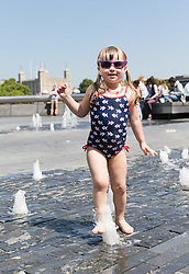 © Licensed to London News Pictures. 26/05/2017. LONDON, UK.  Monica, aged 3 plays in the water fountain on the south bank opposite the Tower of London at lunchtime. The capital has experienced another day of hot and sunny weather. Photo credit: Vickie Flores/LNP