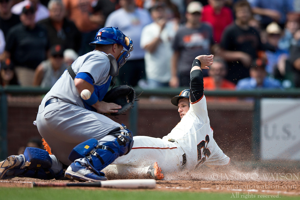 SAN FRANCISCO, CA - MAY 21: Buster Posey #28 of the San Francisco Giants scores a run past A.J. Ellis #17 of the Los Angeles Dodgers during the eighth inning at AT&T Park on May 21, 2015 in San Francisco, California.  The San Francisco Giants defeated the Los Angeles Dodgers 4-0. (Photo by Jason O. Watson/Getty Images) *** Local Caption *** Buster Posey; A.J. Ellis