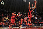 CHAMPAIGN, IL - DECEMBER 30: Duncan Robinson #22 of the Michigan Wolverines goes up to shoot against Maverick Morgan #22 of the Illinois Fighting Illini at Memorial Stadium on December 30, 2015 in Champaign, Illinois. Michigan defeated Illinois 78-68. (Photo by Michael Hickey/Getty Images) *** Local Caption *** Duncan Robinson; Maverick Morgan