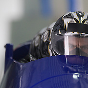"Winter Olympics, Vancouver, 2010.The bobsleigh from Great Gritain in action during the Bobsleigh Four-man competition  at The Whistler Sliding Centre, Whistler, during the Vancouver Winter Olympics. 25th February 2010. Photo Tim Clayton..'BOB'..Images from the Four-man Bobsleigh Competition. Winter Olympics, Vancouver 2010..History was made at the Whistler Sliding Centre when the USA four-man bobsleigh team, led by Steven Holcomb took the Gold. The first time since 1948, a gap of 62 years, since the USA have won an Olympic Bobsleigh gold and they did it with their sleigh named ""Night Train""...The four days of practice and competition show the tension, nervousness and preparation as the teams of hardened men cope with the challenge of traveling at average speeds of over 150 km an hour. Indeed, five teams had already pulled out of the event before the opening heats because of track complexity, speed and fear, and on the final day, another four teams did not start after six crashes in the first two heats...Teams warm up behind the start complex, warming muscles in the cold in preparation for the explosive start. Many teams prepare in silence, mentally preparing themselves as they wait at the top of the run, in the bobsleigh sheds and the loading areas for their turn. When it's time to slide each team performs it's own starting ritual, followed by the much practiced start out of the blocks for just over four seconds, the teams are then in the hands of the accomplished drivers as they hurtle down the track for just over fifty seconds...Spectators clamber for the best position on track to see the sleighs for a split second, many unsuccessfully try to capture the moments on camera, The rumble of the sleigh is heard then the crowds gasp as it hurtles past in a blur...The American foursome of  Steven Holcomb, Justin Olsen, Steve Mesler and Curtis Tomasevicz finished with a pooled four-heat time of 3min 24.46sec. The German team led by Andre Lange won the Silver Medal in a co"