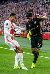 03-05-2017 NED: UEFA Europa Cup AFC Ajax - Olympique Lyonnais, Amsterdam<br /> Ajax heeft zich in de Arena een geweldige uitgangspositie verworven om voor het eerst in 21 jaar een Europese finale te halen. De Amsterdammers wisten Olympique Lyonnais in de eerste halve finale van de Europa League met 4-1 te verslaan / Kenny Tete #2, Nabil Fekir #18