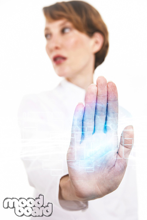 Blurred woman holding out hand against white background