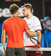 Stanislaus Wawrinka of Switzerland (right) defeated the number one player in the world R. Nadal (left) of Spain to claim the 2014 Australian Open Men's Singles Championship. The Swiss won 6-3 6-2 3-6 6-3 in a match that will be remembered for a confusing and sometimes bizarre final three sets, with Nadal clearly hampered by a left lower back injury and seemingly on the verge of retirement in the second set.. The match was held on center court at Melbourne's Rod Laver Arena.