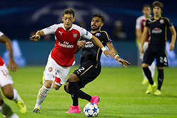 Mesut Ozil #11 of Arsenal F.C. and El Arabi Hilal Soudani #2 of GNK Dinamo Zagreb during football match between GNK Dinamo Zagreb, CRO and Arsenal FC, ENG in Group F of Group Stage of UEFA Champions League 2015/16, on September 16, 2015 in Stadium Maksimir, Zagreb, Croatia. Photo by Urban Urbanc / Sportida